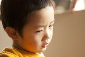 Asian boy thinking