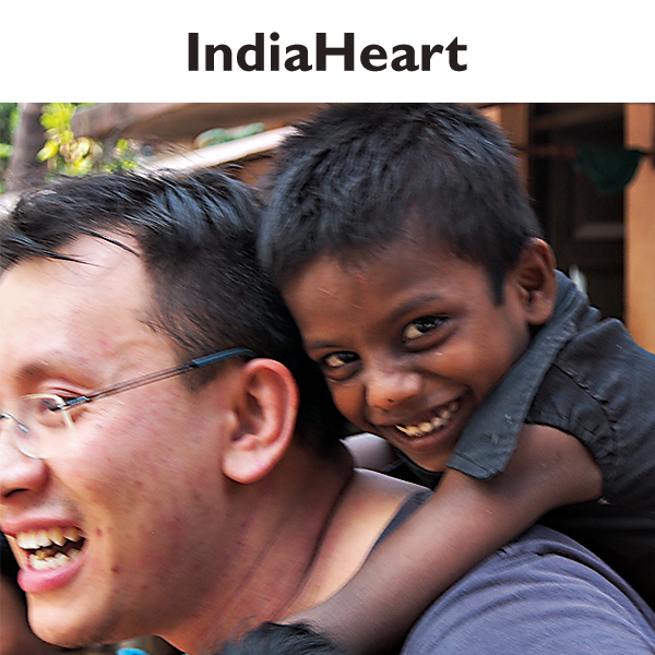 male team member with boy in India