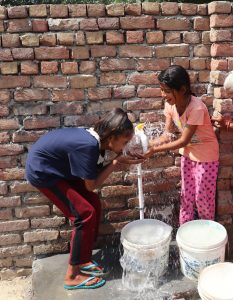 2 children drinking from new water bore