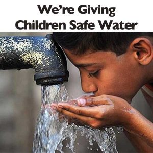 Child drinking water from tap